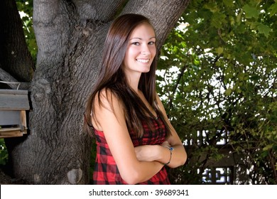 Teenager Posing with her arms crossed