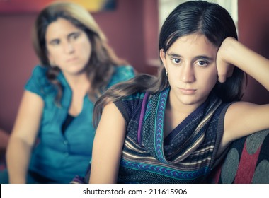 Teenager problems - Defiant teenage girl after a fight with her worried mother