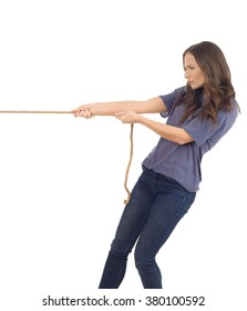 Teenager pulling a rope