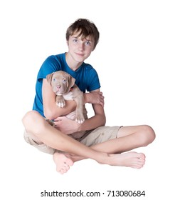 A teenager with a puppy  of the American pit bull terrier on his hands. Isolated on white background