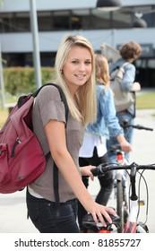 Teenager pushing bike