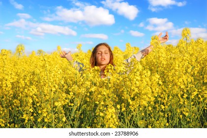 Teenager relaxing in a rapeseed field
