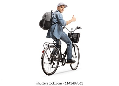 Teenager riding a bicycle and holding his thumb up isolated on white background