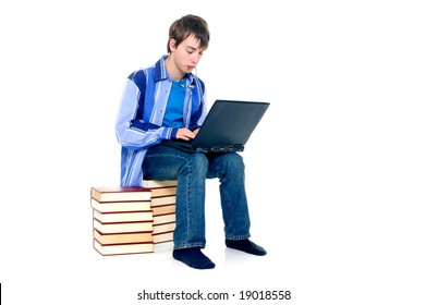 Teenager schoolboy with laptop books on white background