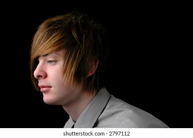 Teenager with shirt and tie over a black background (Profile view)