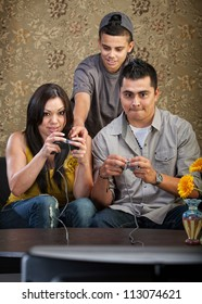 Teenager shows parents how to use video game controllers