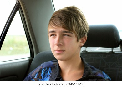 teenager sitting in the car