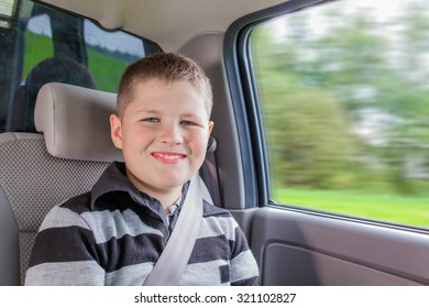 Teenager sitting in a car in safety chair