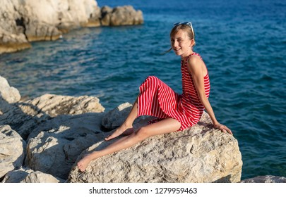 teenager sitting on the beach