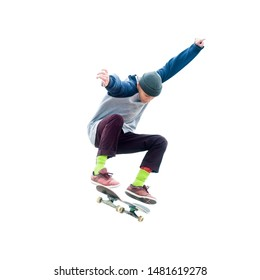 Teenager skateboarder jumps ollie on an isolated white background. The concept of street sports and urban culture