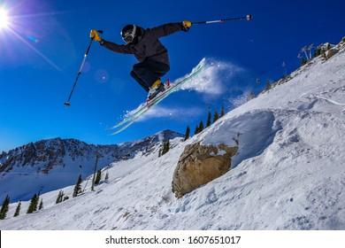 Teenager ski jumping in Alta, Utah