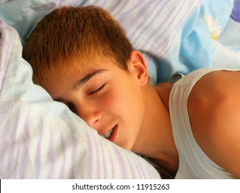 teenager sleeping with a little smile