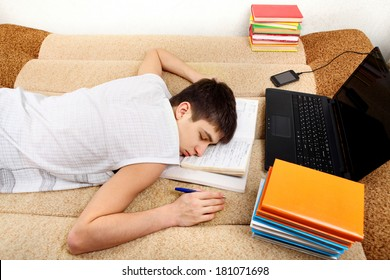 Teenager sleeps after Learning on the Sofa at the Home