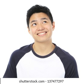 A teenager smiling and looking up