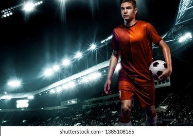 Teenager - soccer player. Man in football sportswear after game with ball. Sport concept.