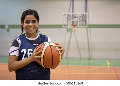 Teenager student girl with a basket ball