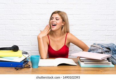 Teenager student girl at indoors yawning and covering wide open mouth with hand