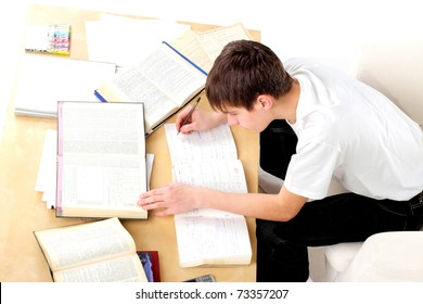A teenager studying hard for the exam
