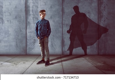Teenager with superhero shadow