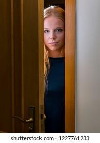Teenager is surprised to open a door