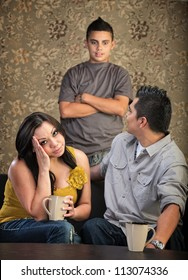 Teenager talking to annoyed parents sitting