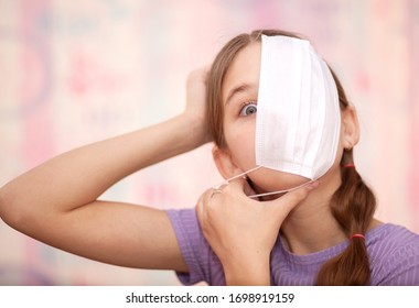 Teenager young girl makes creative content for friends, followers Social network campaign to use soap, face masks, good hygiene to fight coronavirus pandemics. Trendy youth lifestyle, generation zed. - Shutterstock ID 1698919159