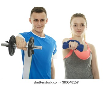 Teenagers boy and girl doing a fitness workout with dumbbells