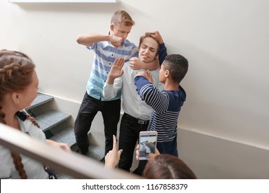 Teenagers bullying their classmate at school