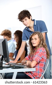 Teenagers in computing class