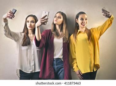 Teenagers doing selfies