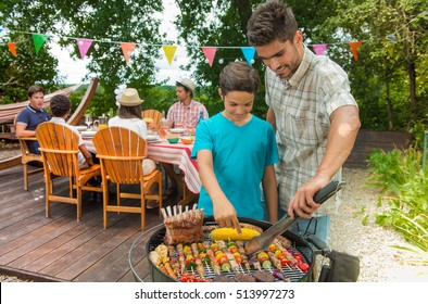 Teenagers during a barbecue at family garden BBQ, outdoor