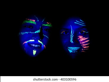 teenagers with face painted on glow party with UV light