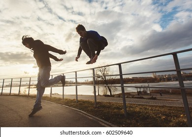 Teenagers jumping parkour