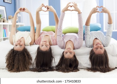 Teenagers making hearth shape with their hands