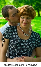 Teenagers: man are kissing girlfriend. Half-length portrait