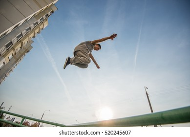 teenagers paired training parkour jump in the urban environment