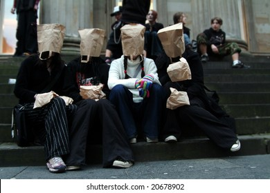 teenagers with paper bags on heads