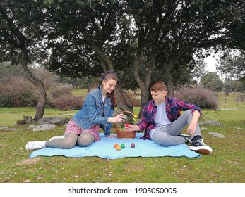 Teenagers in the park play with Easter eggs.  Easter