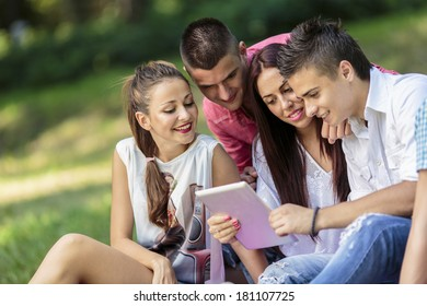 Teenagers in the park with tablet