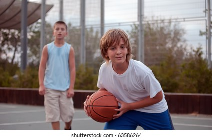 Teenagers play basketball  .