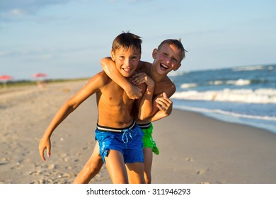 Teenagers playing on the sea beach at summer.