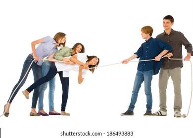teenagers playing tug of wa
