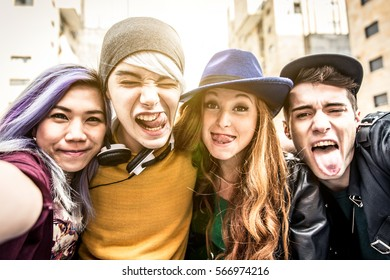 Teenagers portrait. Group of teens hugging and making funny faces at camera