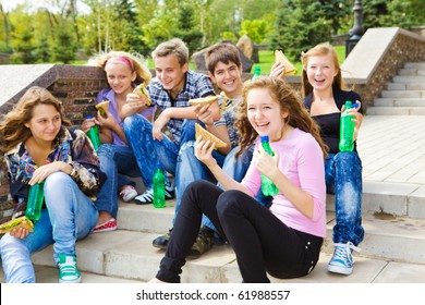 Teenagers with sandwiches and soda