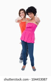 Teenagers showing thumbs up one behind the other against a white background