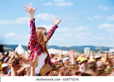 Teenagers at summer music festival enjoying themselves - Shutterstock ID 618775376