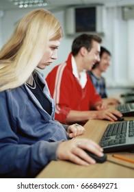 Teenagers using computers