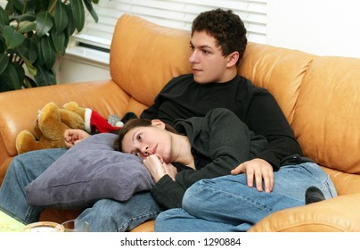 Teenagers watching tv at home