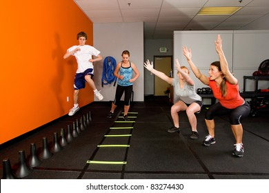 Teenagers working out together in a gym