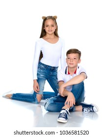 Teens brother and sister. The concept of a happy childhood, beauty, people, fashion, healthy lifestyle. Isolated on white background.